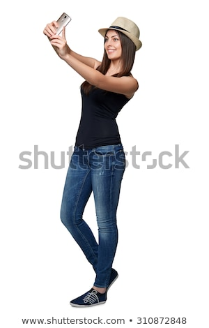 pretty young woman smiling and shooting herself stock photo © deandrobot