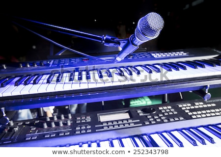 keyboard player is working in studio stock photo © paha_l