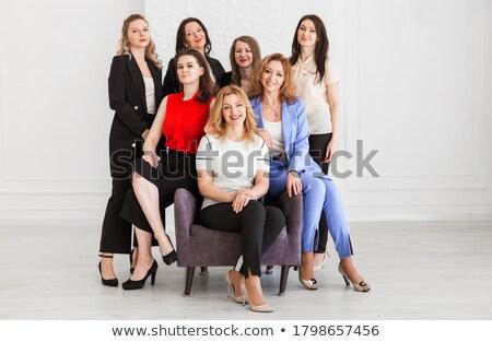empresária · posando · estúdio · belo · alegre · mulher · loira - foto stock © NeonShot