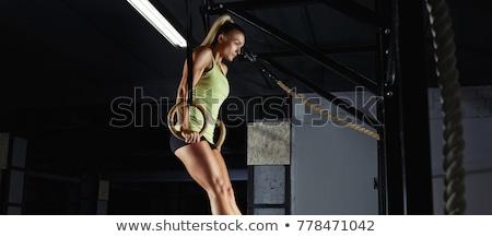 Lány tornász gyűrűk fitt testmozgás fehér Stock fotó © kokimk