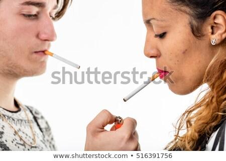 woman lightin a cigarette to a man Stock photo © Giulio_Fornasar