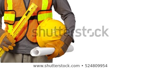 Hands of construction worker with helmet and level. Stock photo © Kurhan