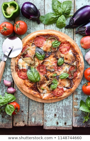 Slice of Tomato Mozzarella Aubergine and Basil Pizza stock photo © monkey_business