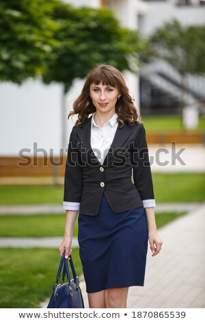 young pretty cool fashion business lady wearing black suit and o stock photo © iordani