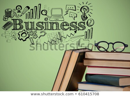 Stock photo: Pile of books and glasses with black business doodles against green background