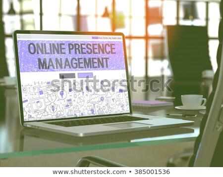 Online Presence Management Concept on Laptop Screen. Stock photo © tashatuvango