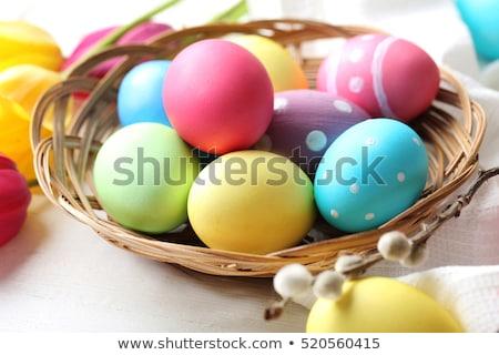 Basket with colored eggs Stock photo © bedlovskaya