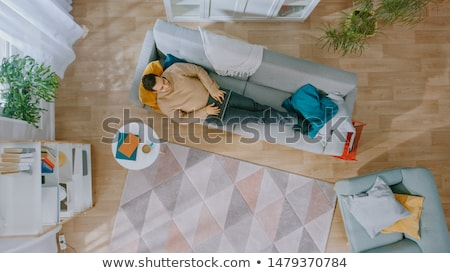 Young man lying on rug Stock photo © IS2