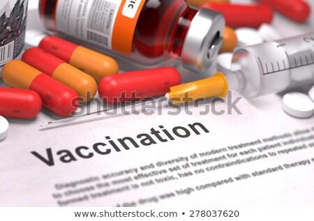 Vaccinazione stampata diagnosi arancione offuscata testo Foto d'archivio © tashatuvango