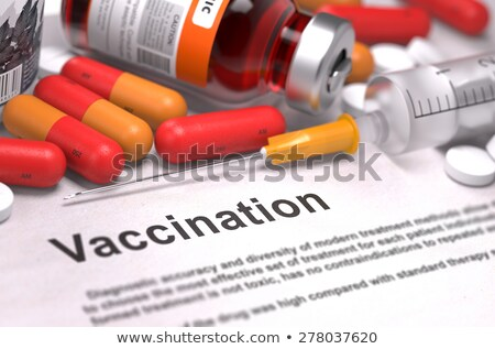 vaccination   printed diagnosis on orange background stock photo © tashatuvango
