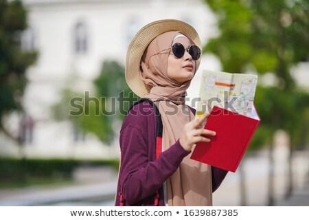Muslim traveler with backpack looking at map. Stock photo © RAStudio