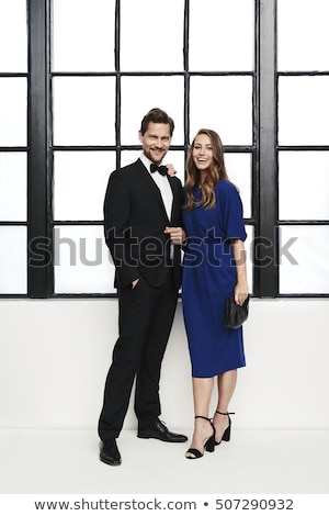 Laughing couple in formal wear Stock photo © LightFieldStudios