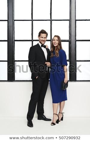 laughing couple in formal wear stock photo © lightfieldstudios
