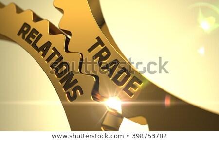 International Cooperation Concept. Golden Metallic Gears. Stock photo © tashatuvango