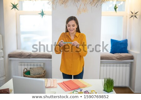 Picture of good looking woman in light clothes standing  Stock photo © Traimak