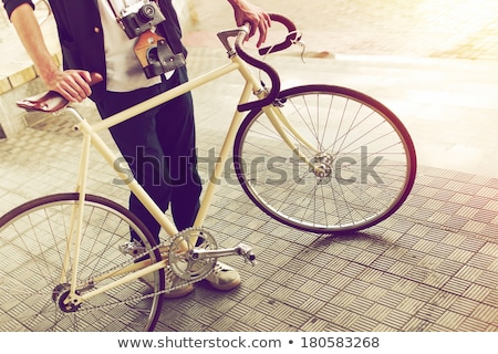 Hipster woman with vintage road bike in city Stock photo © blasbike