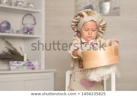 young girl rolling dough Stock photo © IS2