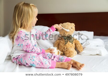 Two children feeding a toy bear Stock photo © IS2