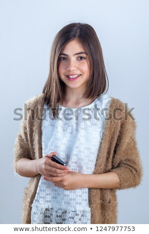 Portrait of teenage female with mobile Stock photo © IS2