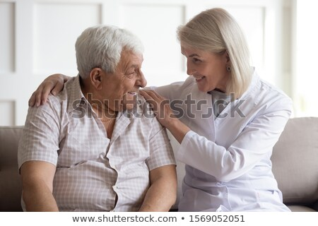 Female doctor embracing a woman patient Stock photo © Giulio_Fornasar