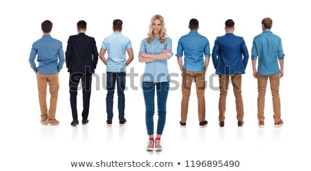 casual female leader stands behind her team of men stock photo © feedough