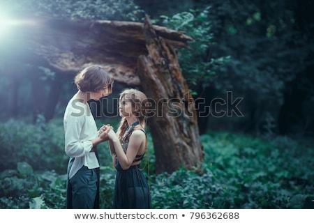 Fiatal pér szeretet szabadtér áll varázslatos erdő Stock fotó © artfotodima