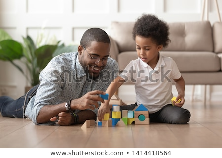father and baby playing with toy blocks at home Stock photo © dolgachov