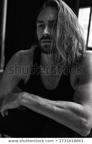 Retrato atraente mulher sexy cabelo preto mão cara Foto stock © artjazz
