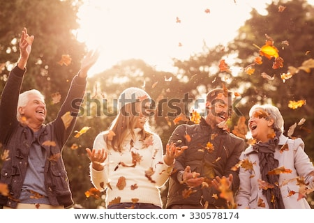 Stock photo: A happy father and daughter having fun in autumn park