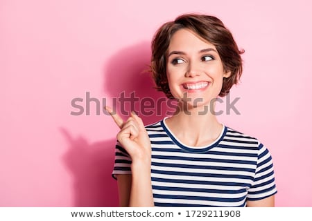 Brunette girl with colorful hair surprised looking at price of green dress. Stock photo © studiolucky