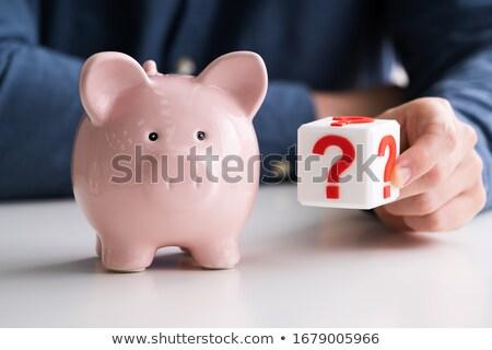 Férfi tart kérdőjel persely pénz takarékosság Stock fotó © AndreyPopov