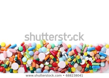 Сток-фото: таблетки · медицинской · падение · бутылку · синий