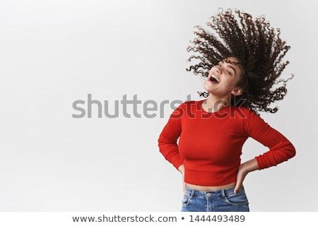 portré · boldog · fiatal · lány · göndör · haj · integet · mobiltelefon - stock fotó © deandrobot