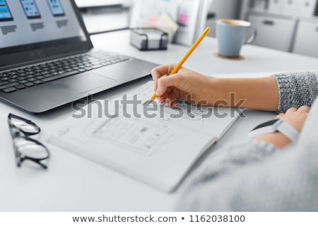 ui designer with user interface sketch in notebook stock photo © dolgachov