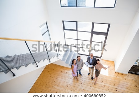 couple with tablet pc computer moving to new home stock photo © dolgachov