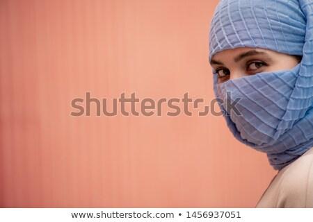 Młodych Muzułmanin kobiet twarz ukryty za Zdjęcia stock © pressmaster