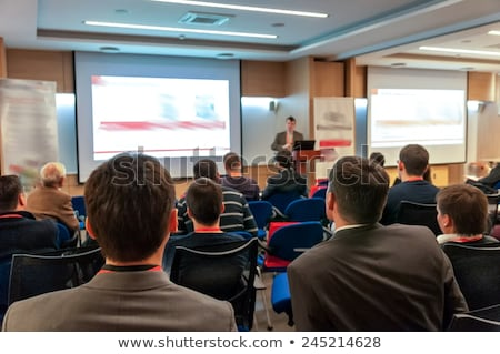 Businessman on podium speaking at conference with screen Stock photo © wavebreak_media