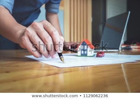 Adam imzalamak ev sigortası ev işadamı Stok fotoğraf © Freedomz