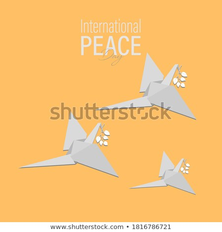 Peace Day September 21 Planet with Flying Doves Stock photo © robuart