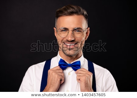 man in shirt and bowtie over black background Stock photo © dolgachov