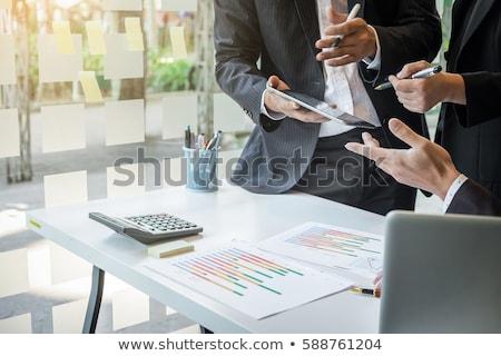 Teamwork process, Business adviser analyzing financial figures d Stock photo © Freedomz