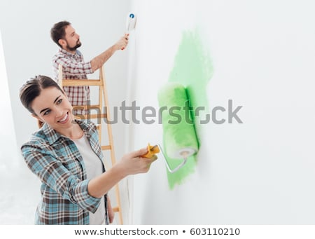 young couple enjoying painting at home stock photo © elnur