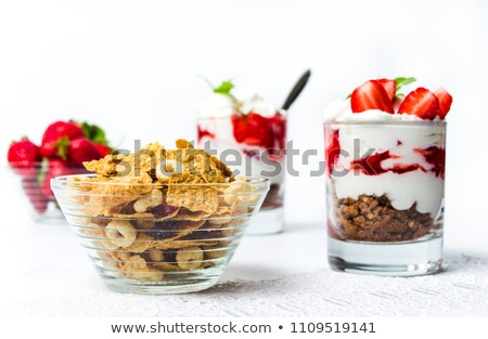 Homemade granola parfait with strawberry jam and mint, yogurt an Stock photo © Anneleven