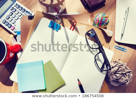 calculator, coffee and blank note on a table Stock photo © nito