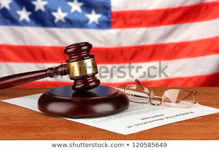 Judge Gavel Over Papers Of Law On Table Stock photo © AndreyPopov