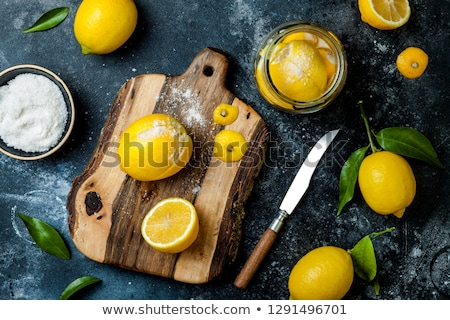 Preserved Lemons with salt on a wooden board Stock photo © joannawnuk