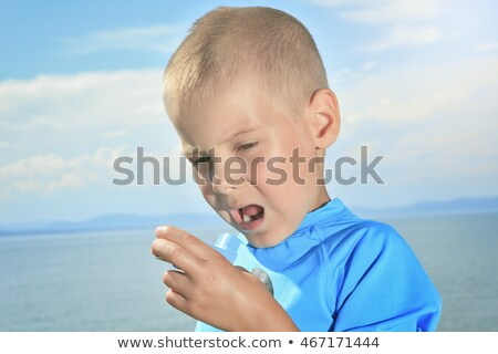 young sport boy using inhaler outside Stock photo © Lopolo