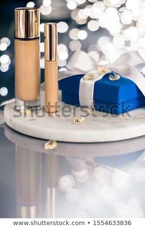 Holiday make-up foundation base, concealer and blue gift box, lu Stock photo © Anneleven