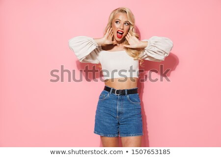 Delighted pleased adorable woman with curly blonde hair and warm blue eyes, being in good mood as re Stock photo © vkstudio