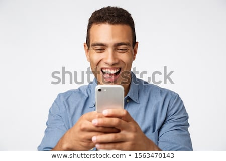 Cheerful, enthusiastic and happy young handsome guy photographing friends say cheeze, using smartpho Stock photo © benzoix